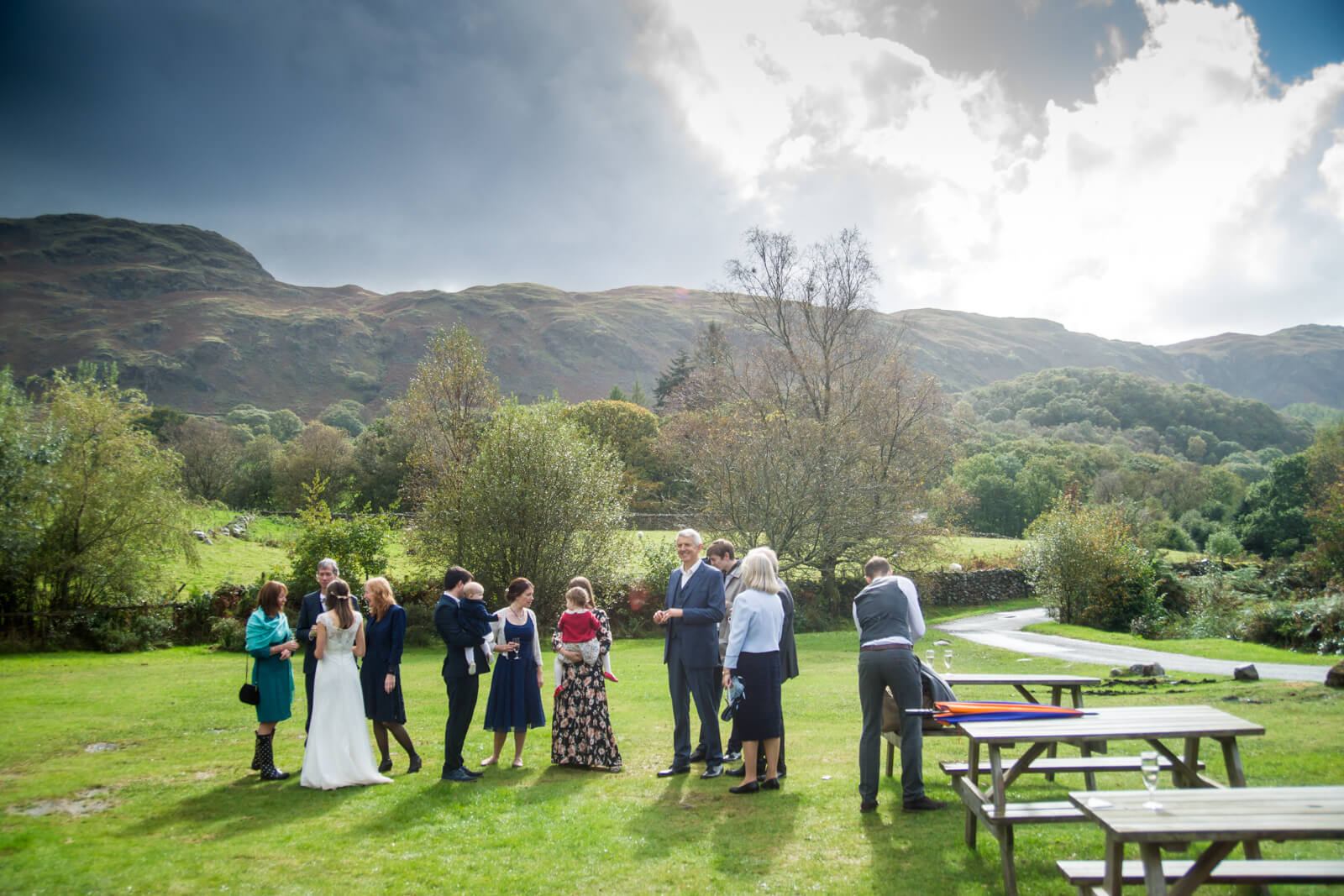 Guests on the lawn with lake district mountains in the background