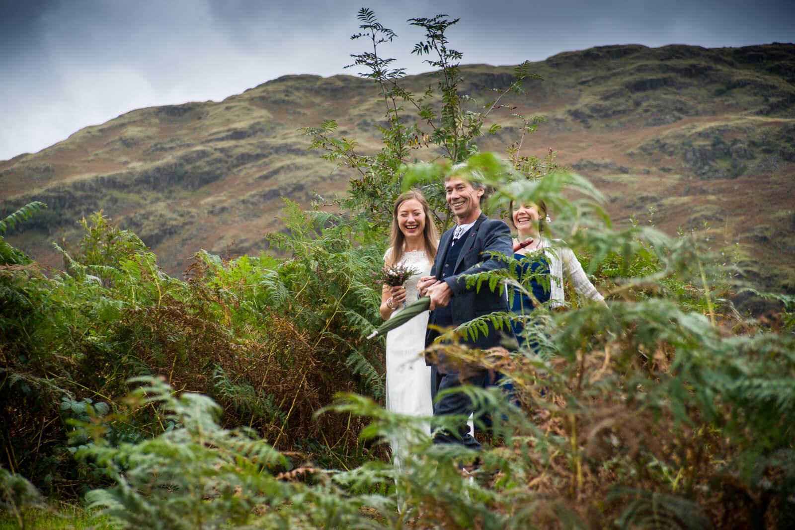 Bride and her father walk through the bracken on their way to the outdoor ceremony