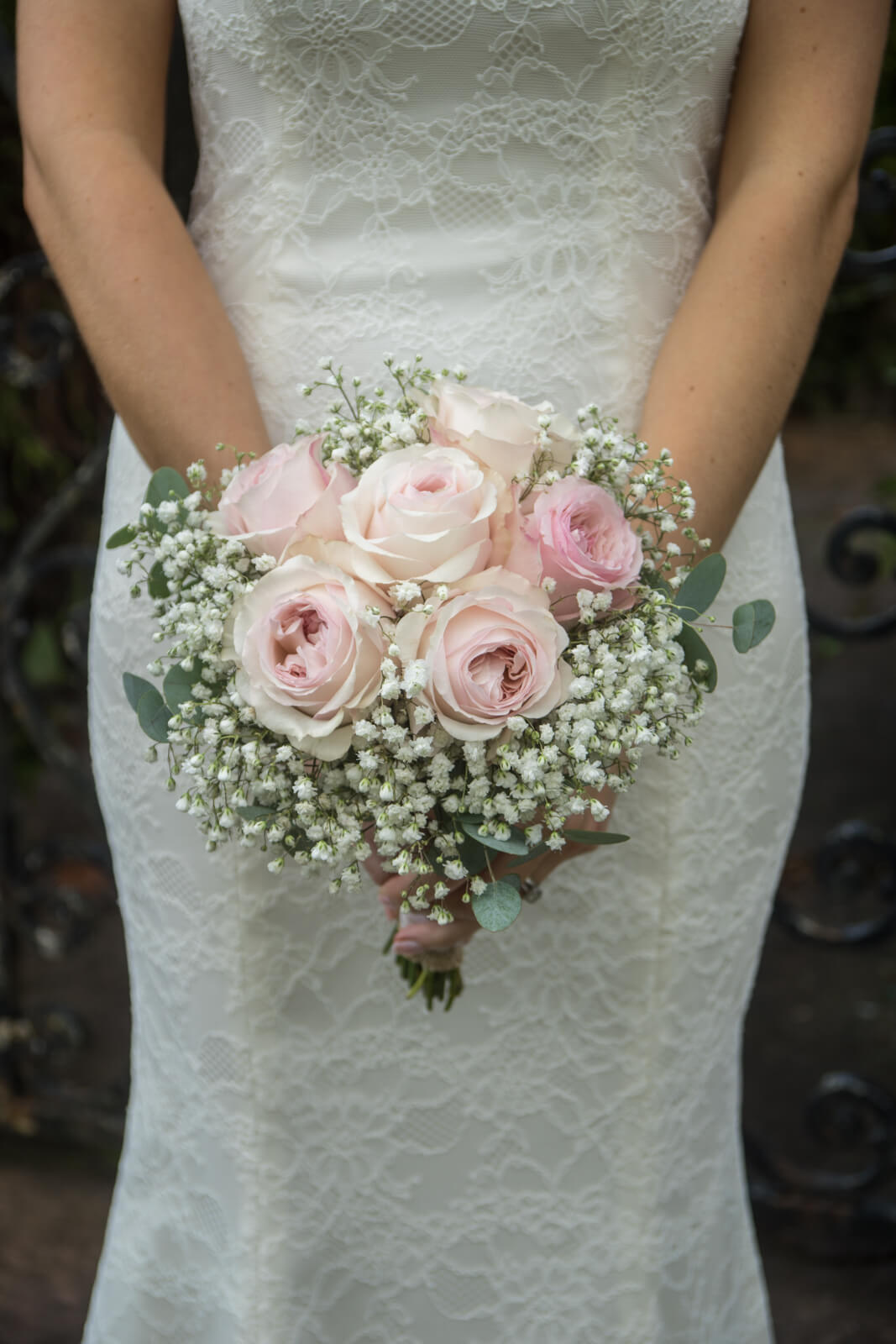 Bridal bouquet with pink david austin roses and gypsophila.