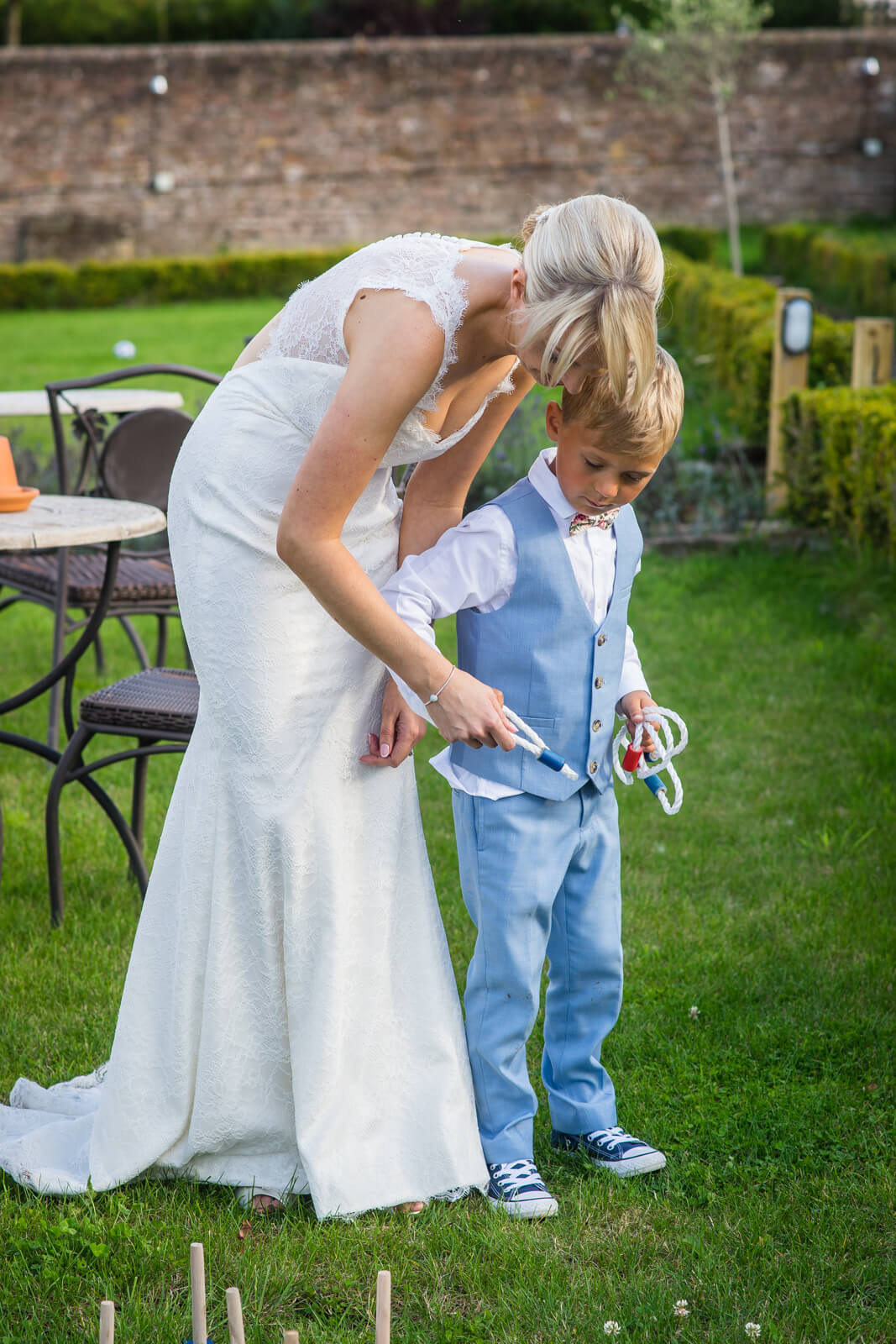 Bride and son playing hoopla together