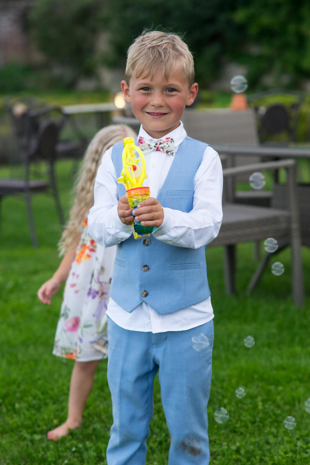 Page boy with a water pistol points it at the camera