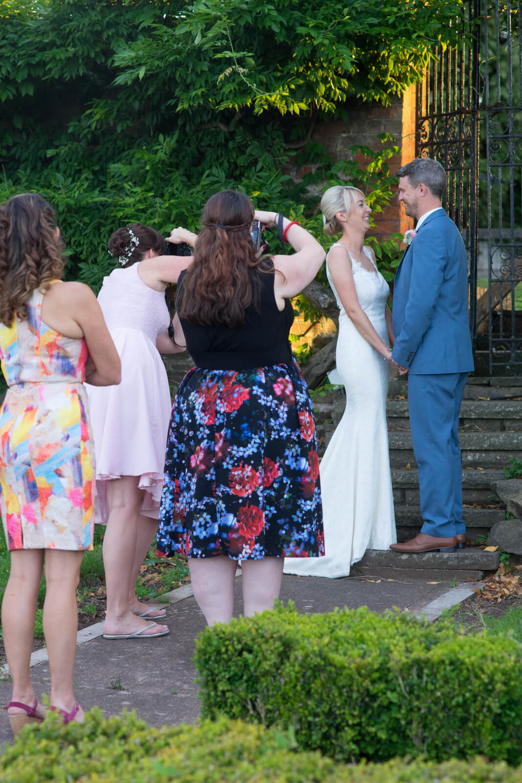 Guests take pictures of the newlyweds