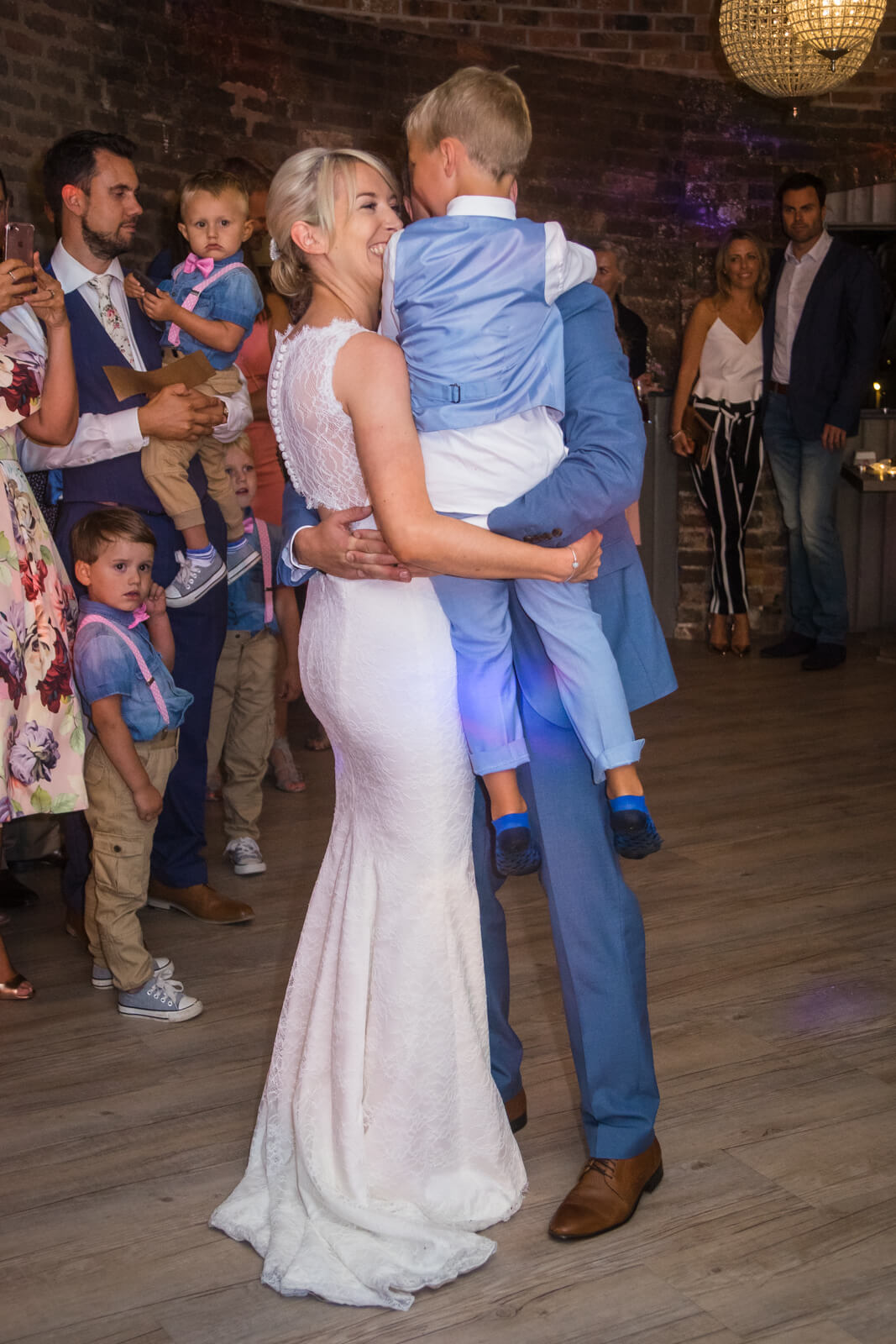 Bride and groom share their first dance with their son.