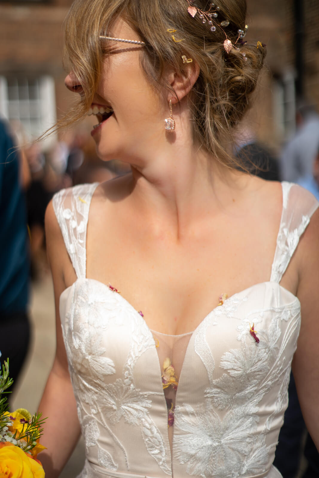 Bride laughs to find confetti down the cleavage of her low cut dress