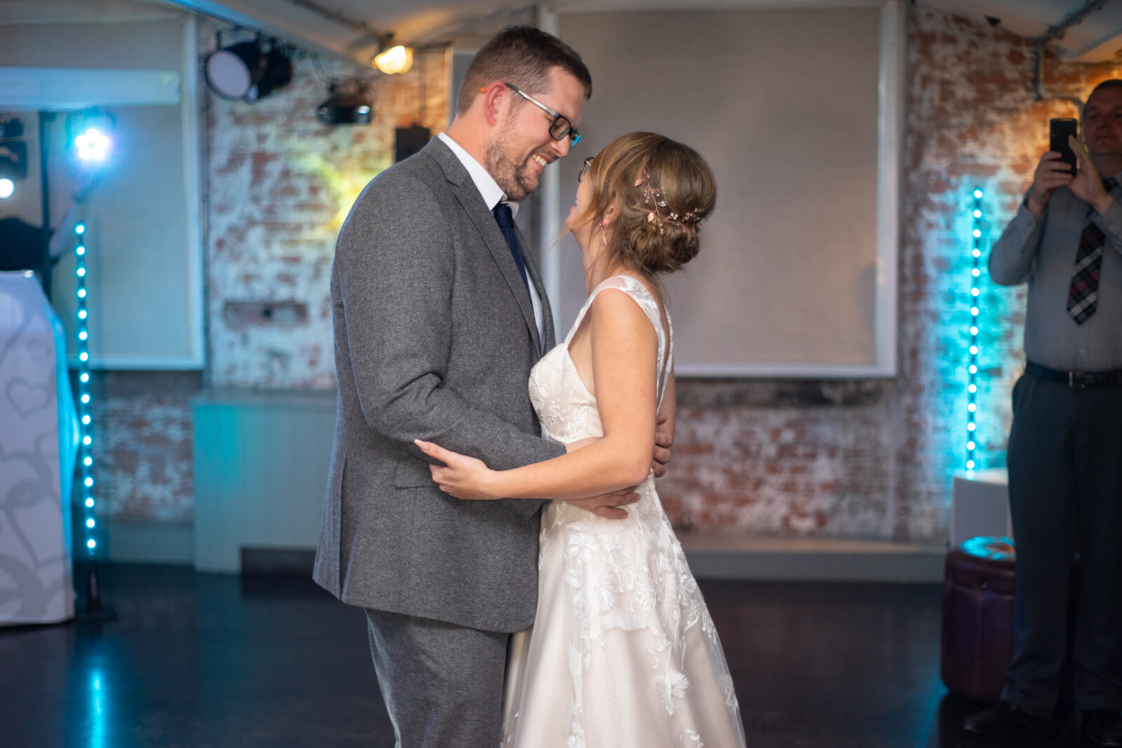 Bride and groom look at each other during their first dance