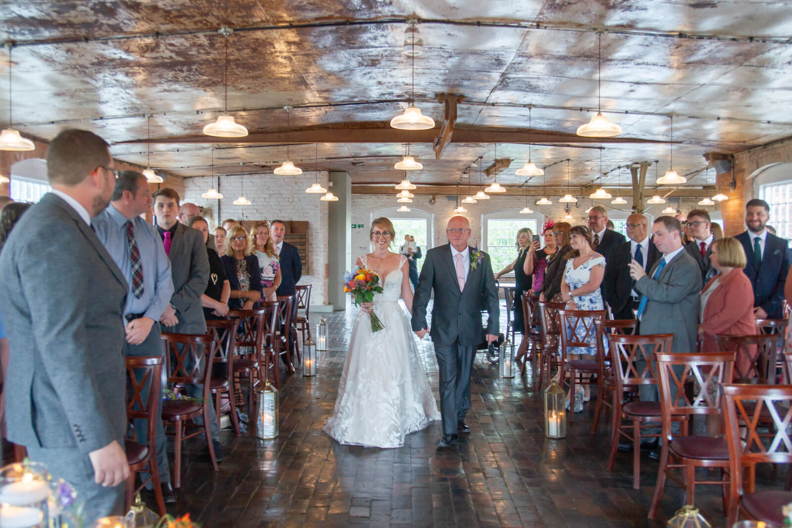Father of the bride walks his daughter down the aisle at the west mill derby