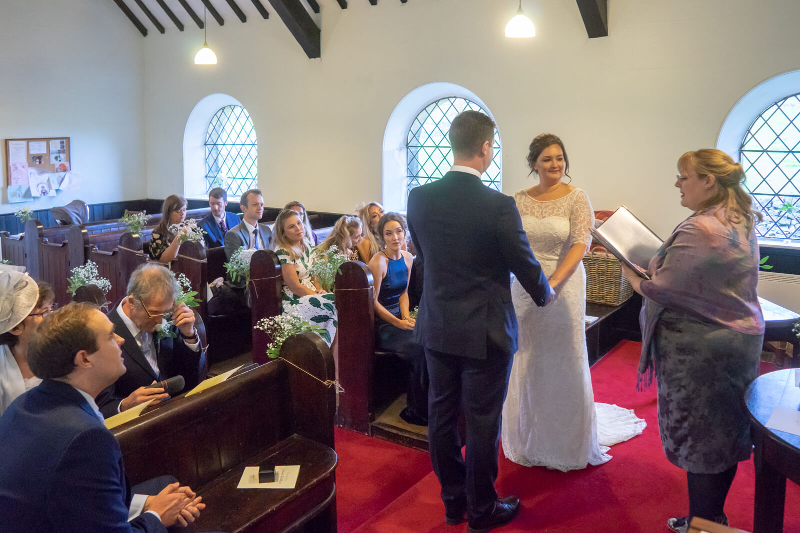 Small chapel wedding with celebrant and congregation