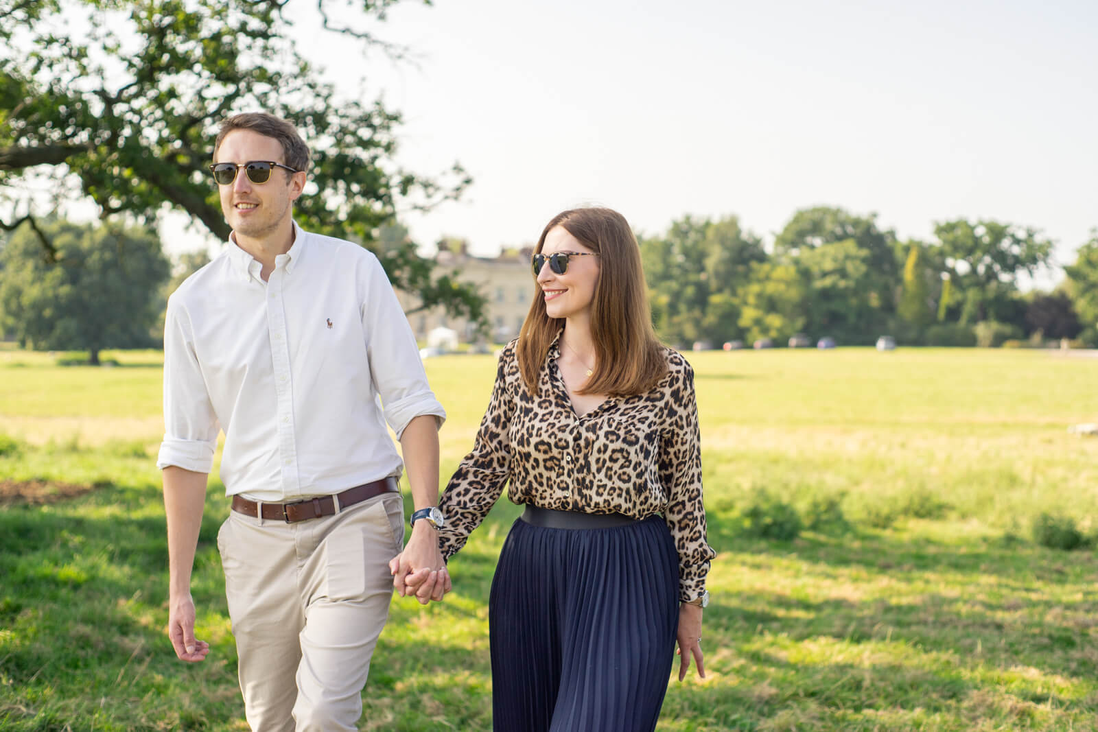Couple walking together on a sunny day wearing sunglasses