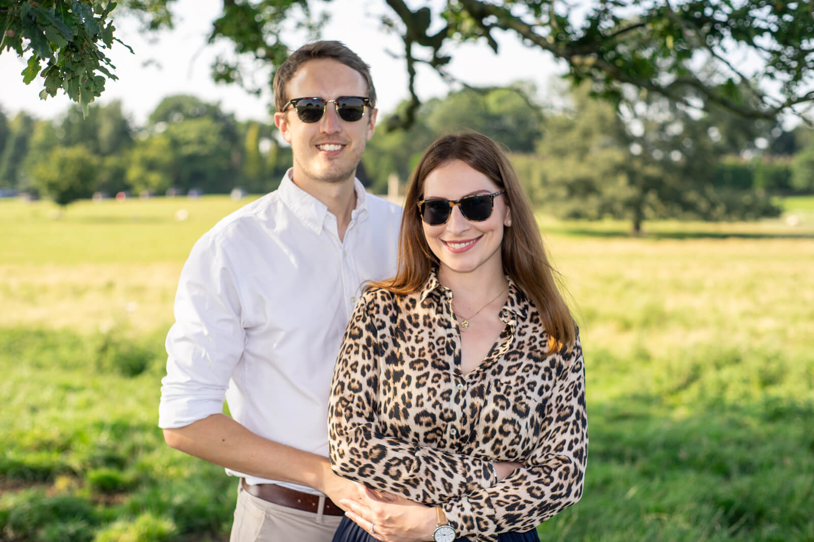 Young couple standing in a field facing the camera