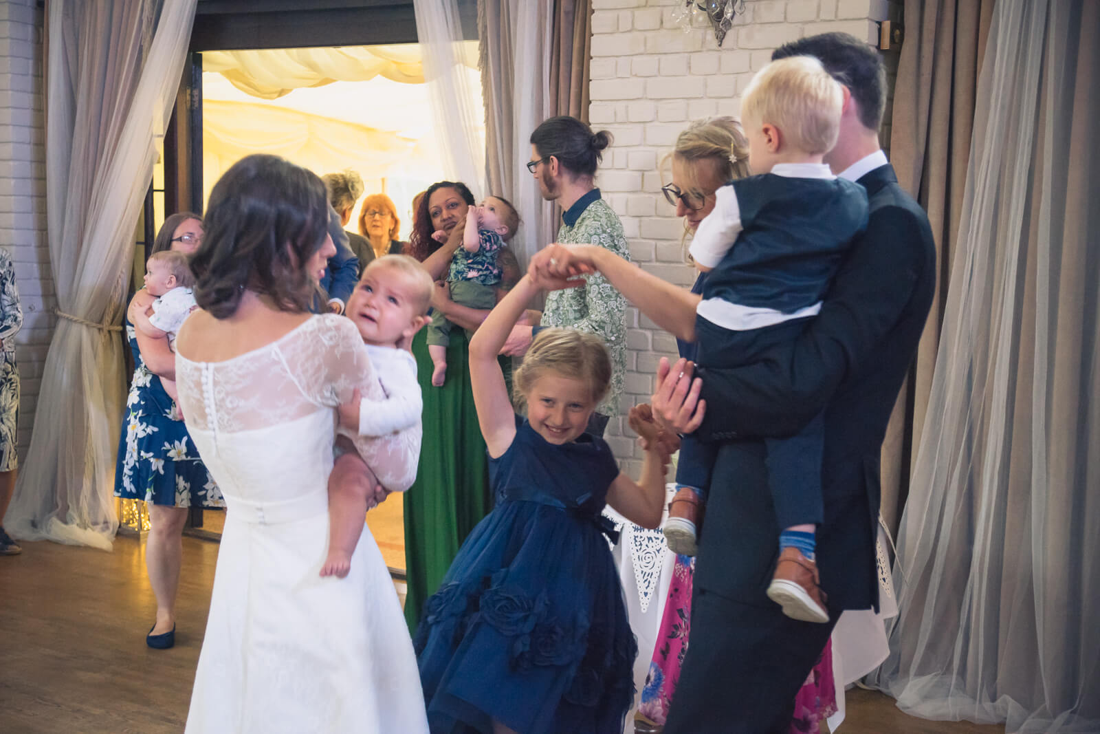 Family and children dance at wedding reception