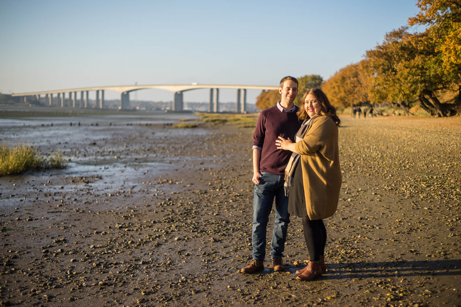 Engaged couple in front of the Orwell Bridge in the evening sun