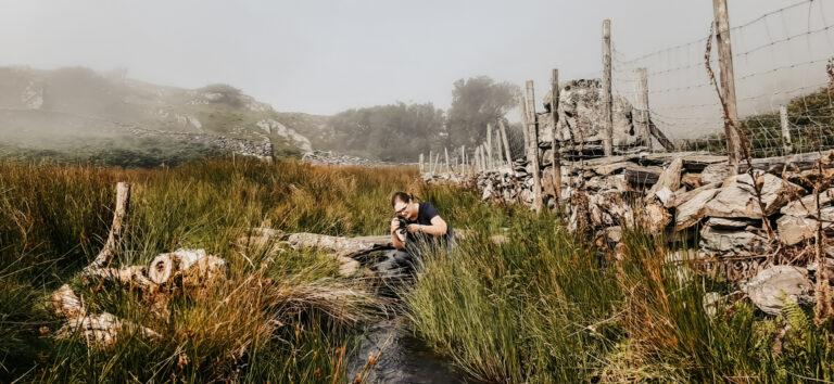 Emma Duder in a stream